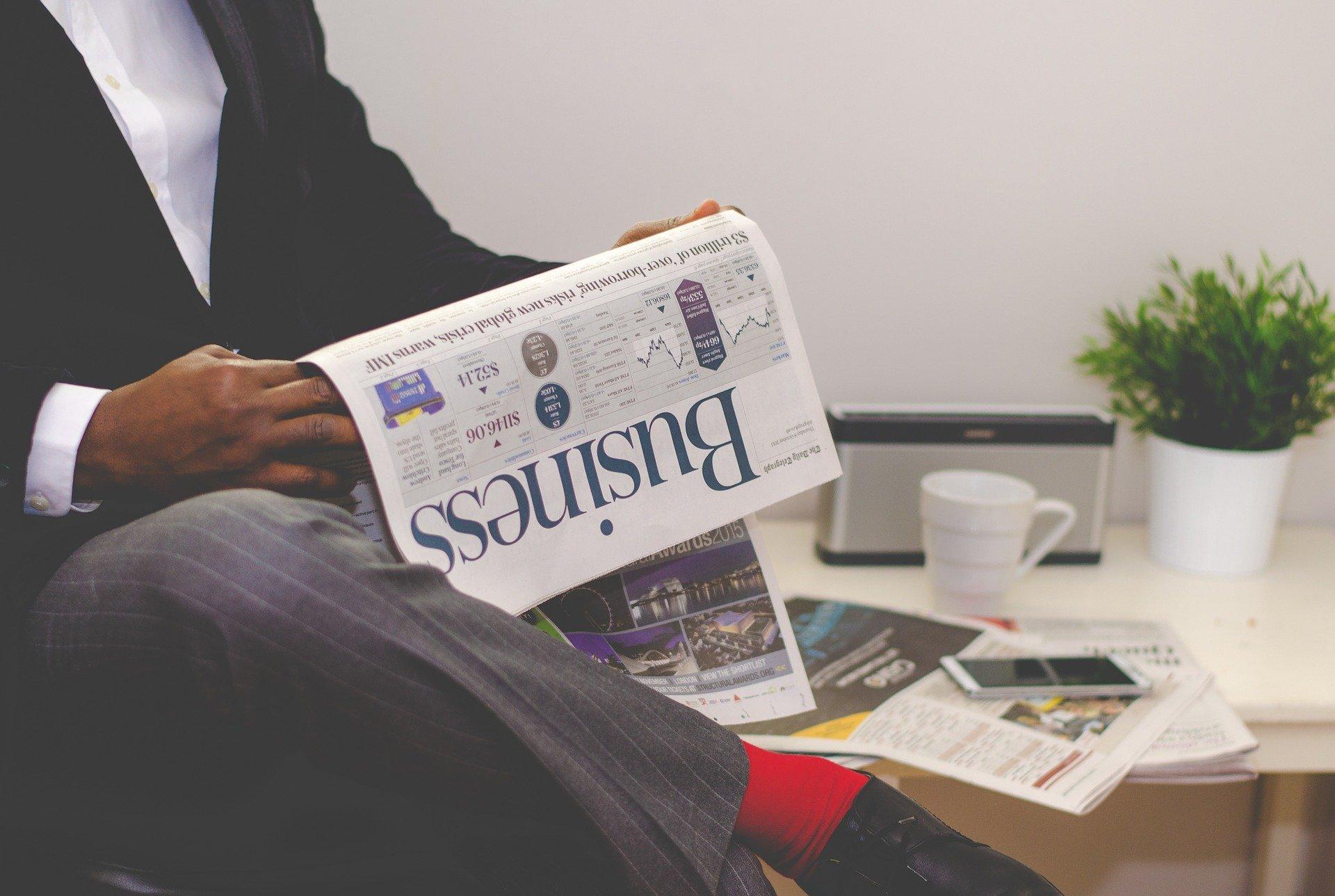 Entrepreneur Reading Newspaper
